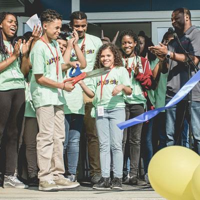 Kids Cutting Ribbon